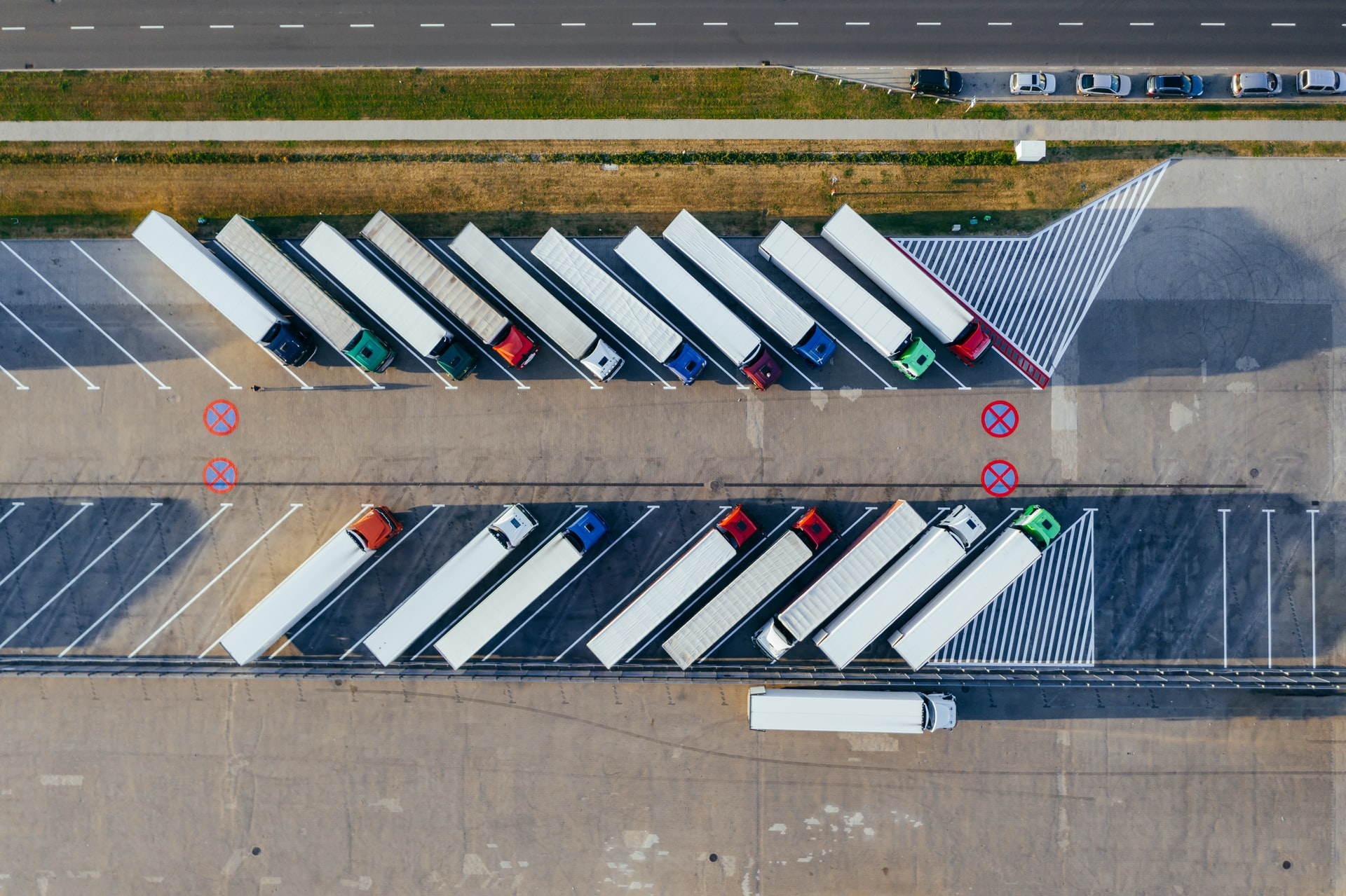 An arial shot of two rows of HGVs parked diagonally and pointing to the right of the frame.