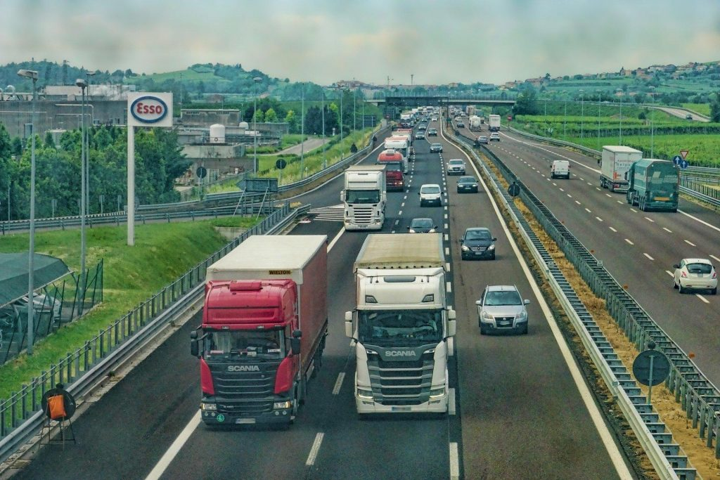 Multiple HGV lorries driving up a motorway