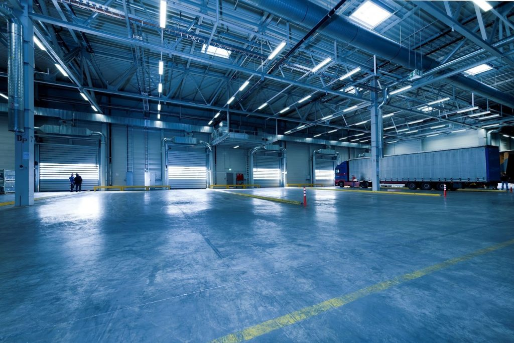an empty warehouse where truck drivers drop off and pick up deliveries
