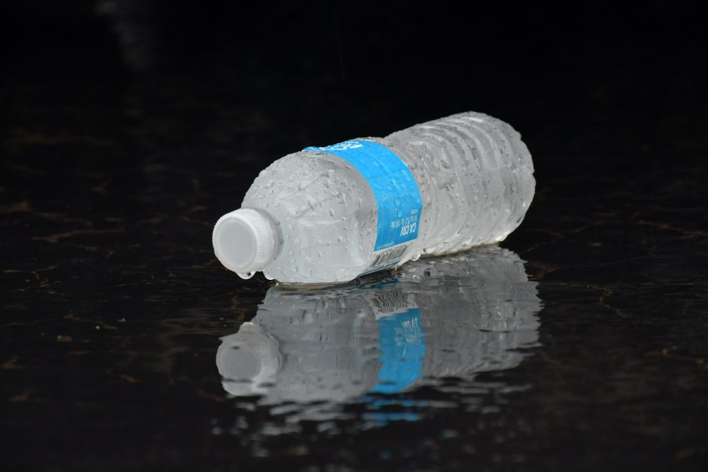 bottle of water: drinking water is a great way to stay cool in your hgv this summer